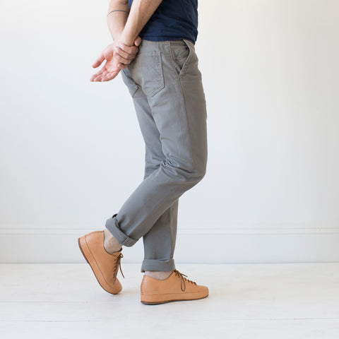 angle: pebble | Raleigh Denim Workshop men's Jones thin fit canvas pants in medium gray pebble, front flat view