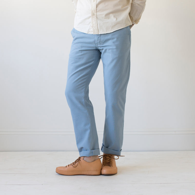 angle hover: water  Raleigh Denim Workshop men's Jones thin fit canvas pants in blue water.