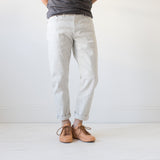 angle hover: natural heather  A model wears Raleigh Denim Workshop Graham work taper fit jeans in white, front view