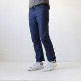 angle: chevron II  A model wears Raleigh Denim Workshop Jones thin fit selvage raw jeans in blue, front view