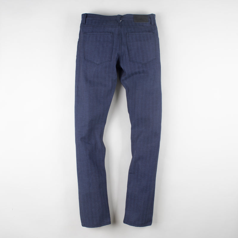 angle: chevron II  Raleigh Denim Workshop Jones thin fit selvage raw jeans in blue, back flat view