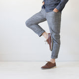 angle: greyhall  A model wears Raleigh Denim Workshop Graham work taper fit jeans that are in gray, front view
