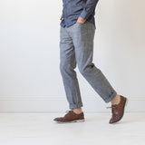 angle hover: greyhall  A model wears Raleigh Denim Workshop Graham work taper fit jeans that are in gray, front view