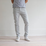 angle: mercury  A model wears Raleigh Denim Workshop Martin fit stretch pants in white, front view