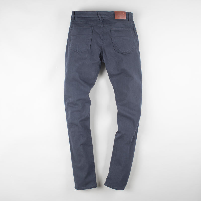 angle: iron blue  Raleigh Denim Workshop Martin thin taper fit stretch pants in dark blue, back flat view
