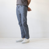 angle: chambray  Raleigh Denim Workshop Martin thin taper fit men's jeans in blue selvage raw chambray.