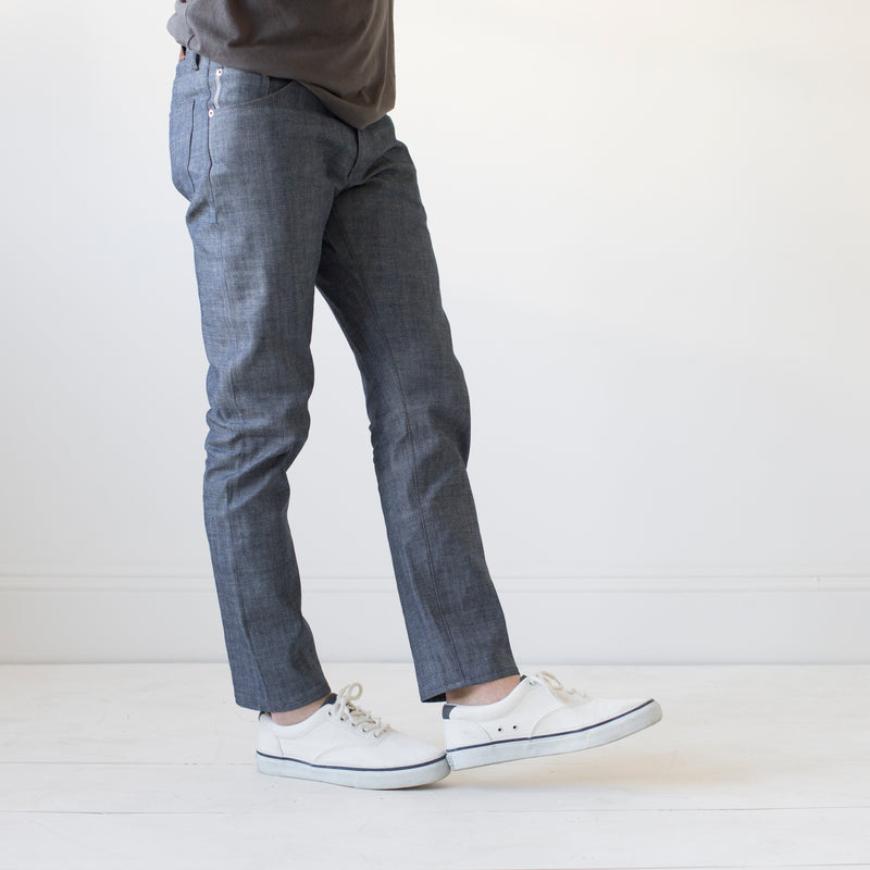 angle hover: chambray  Raleigh Denim Workshop Martin thin taper fit men's jeans in blue selvage raw chambray.
