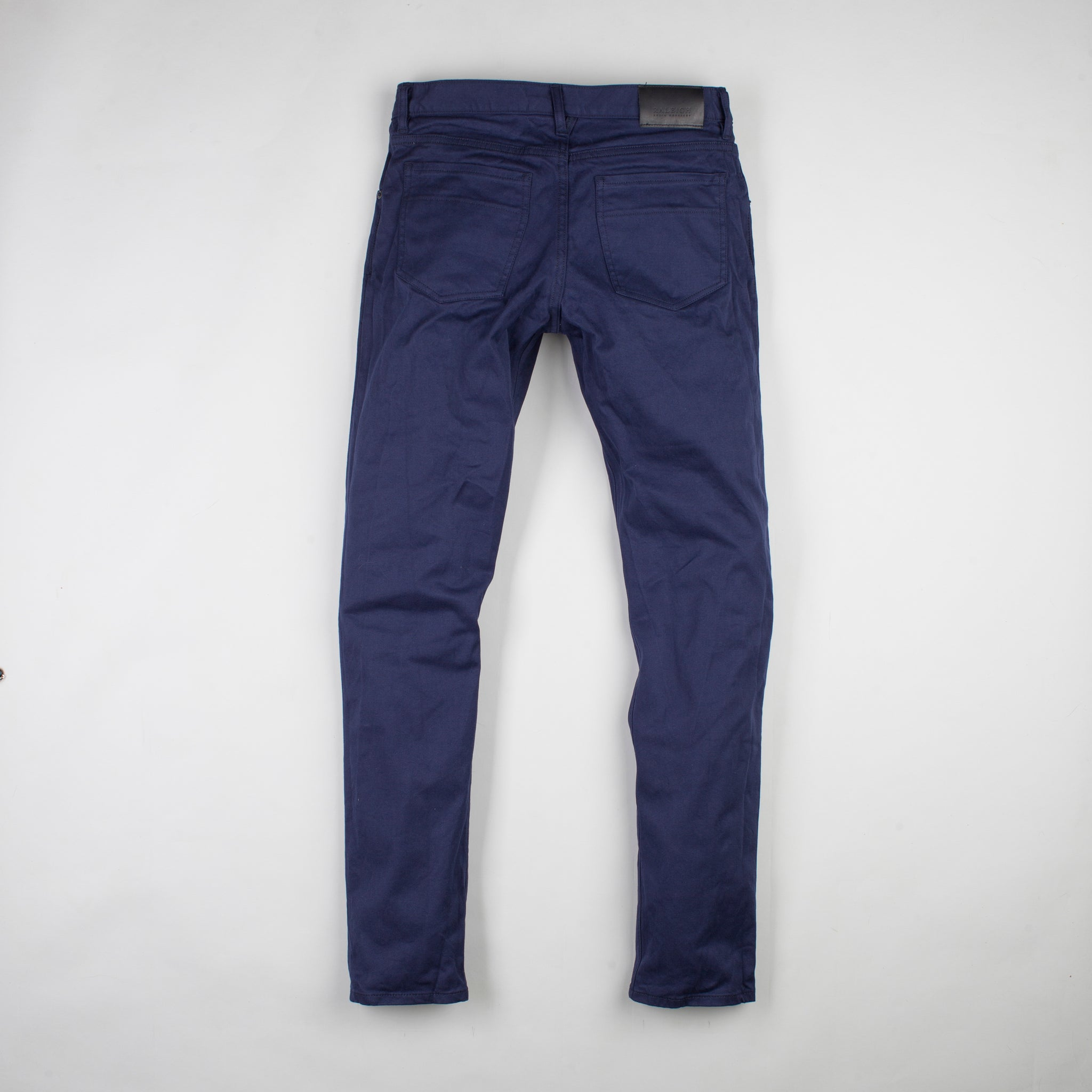 angle: navy polo rinse  Raleigh Denim Workshop Martin thin taper fit men's pants in navy polo rinse.