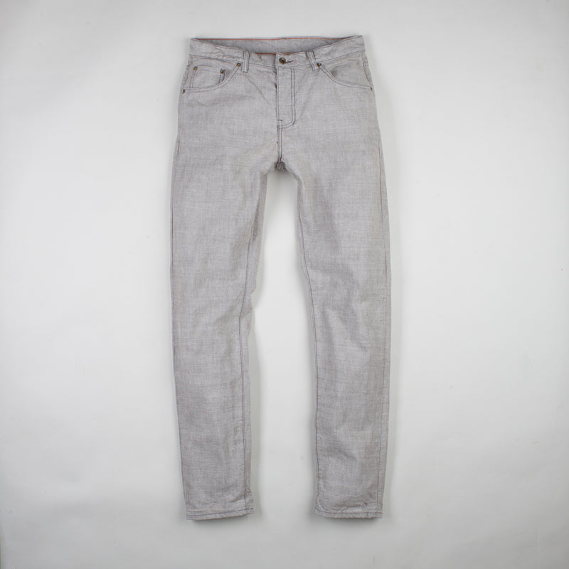 angle: skyline  Raleigh Denim Workshop Graham work taper fit jeans that are in light gray, front flat view