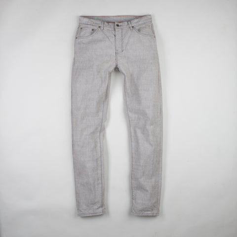 angle: skyline | Raleigh Denim Workshop Graham work taper fit jeans that are in light gray, front flat view