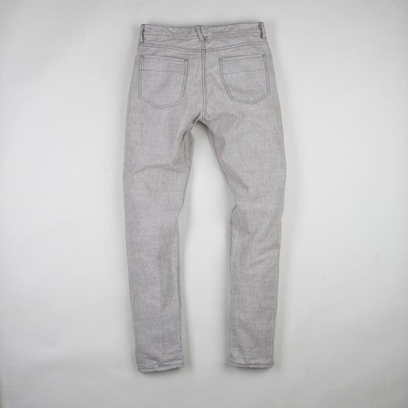 angle: skyline  Raleigh Denim Workshop Graham work taper fit jeans that are in light gray, back flat view