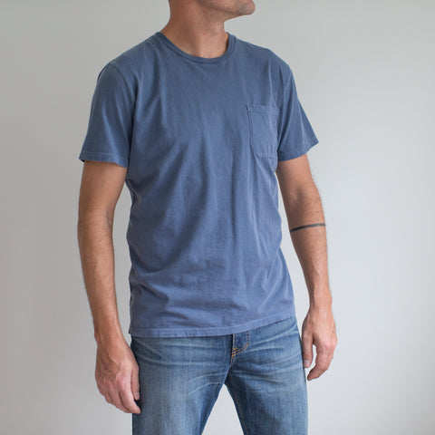 angle: navy | A model wears Raleigh Denim Workshop cotton pocket crew neck tee in navy, front flat view