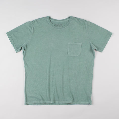 angle: green | A model wears Raleigh Denim Workshop cotton pocket crew neck tee in green, front view
