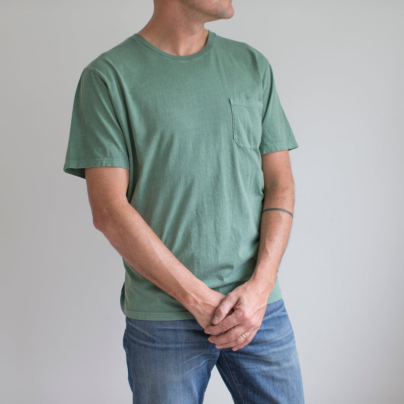 angle: green  A model wears Raleigh Denim Workshop cotton pocket crew neck tee in green, front view
