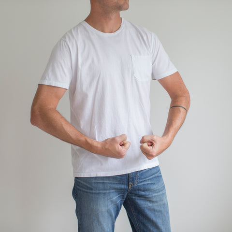 angle: white | A model wears Raleigh Denim Workshop cotton pocket crew neck tee in white, front view