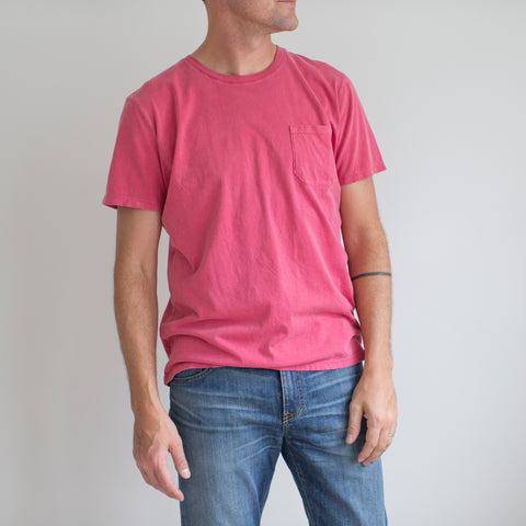 angle: red | A model wears Raleigh Denim Workshop cotton pocket crew neck tee in red, front view