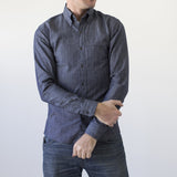 angle: denim  A model wears Raleigh Denim Workshop Welt-Pocket Button-up men's shirt in denim, front view
