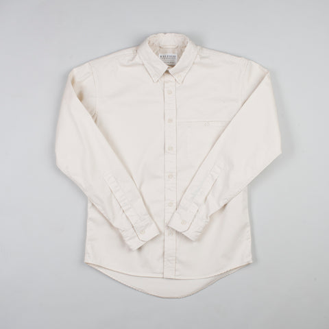 angle: ivory twill | Raleigh Denim Workshop men's welt-pocket button-up shirt in white ivory twill.