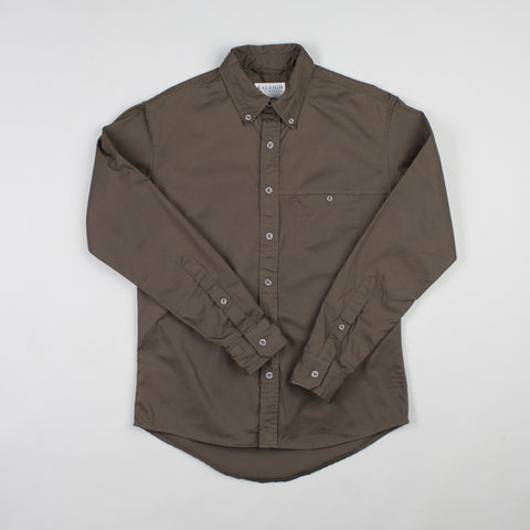 angle: olive twill | Raleigh Denim Workshop men's welt-pocket button-up shirt in dark green olive twill.