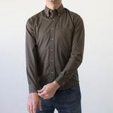 angle: olive twill  Raleigh Denim Workshop men's welt-pocket button-up shirt in dark green olive twill.