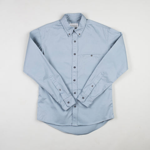 angle: fog twill | Raleigh Denim Workshop men's welt-pocket button-up shirt in light blue fog twill.