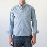 angle: fog twill  Raleigh Denim Workshop men's welt-pocket button-up shirt in light blue fog twill.