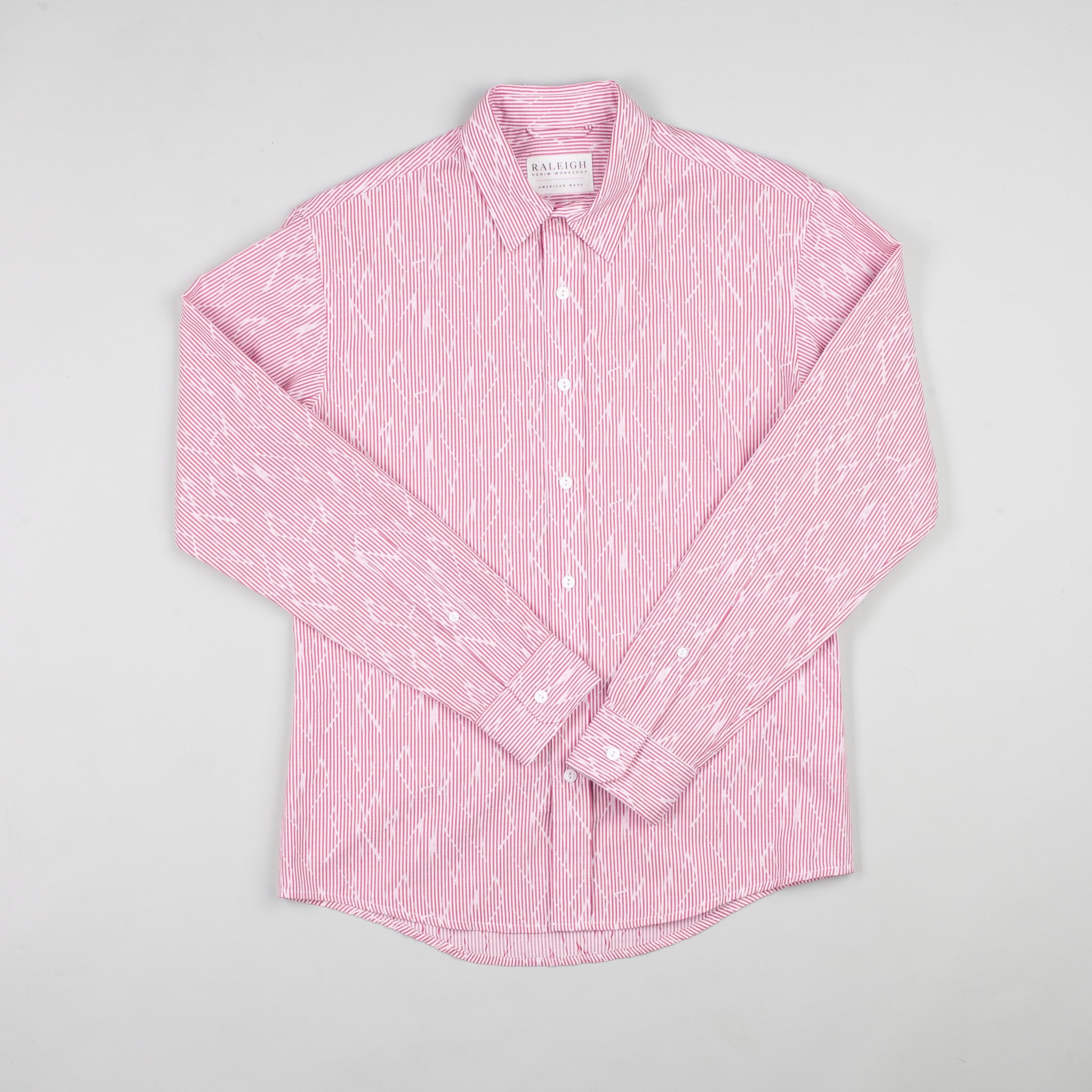 angle hover: voltage  Raleigh Denim Workshop men's classic button-up shirt in red/pink voltage.