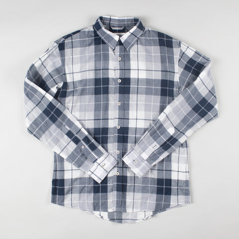 angle: specter blue plaid | A model wears Raleigh Denim Workshop Classic Button-up Men's Shirt in blue plaid, front view