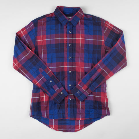 angle: vernon red/blue plaid | A model wears Raleigh Denim Workshop Classic Button-up Men's Shirt in red and blue plaid, front view