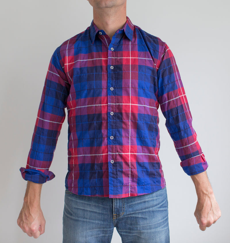 angle: vernon red/blue plaid  A model wears Raleigh Denim Workshop Classic Button-up Men's Shirt in red and blue plaid, front view