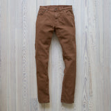 angle: cedar  Raleigh Denim Workshop Martin thin taper fit stretch pants in brown-orange cedar, front