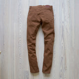 angle: cedar  Raleigh Denim Workshop Martin thin taper fit stretch pants in brown-orange cedar, back