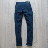 angle: space blue  Raleigh Denim Workshop Martin thin taper fit stretch pants in navy space blue, back