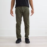 angle hover: dark moss  Raleigh Denim Workshop a model wears martin stretch dark moss front