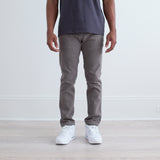 angle: stainless  Raleigh Denim Workshop a model wears Martin thin taper fit stretch pants in grey stainless, front