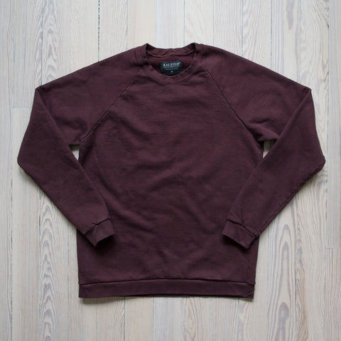 angle: currant | A Raleigh Denim Workshop sweatshirt in currant