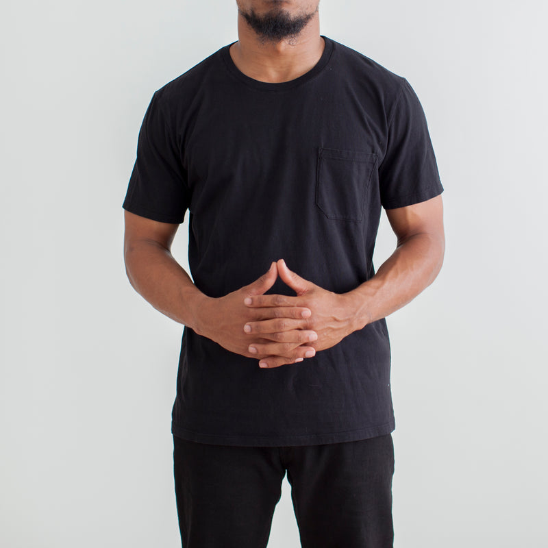 angle: black  Raleigh Denim Workshop a model wears cotton pocket crew neck tee in black
