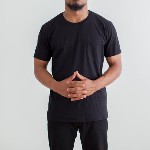 angle: black | Raleigh Denim Workshop a model wears cotton pocket crew neck tee in black