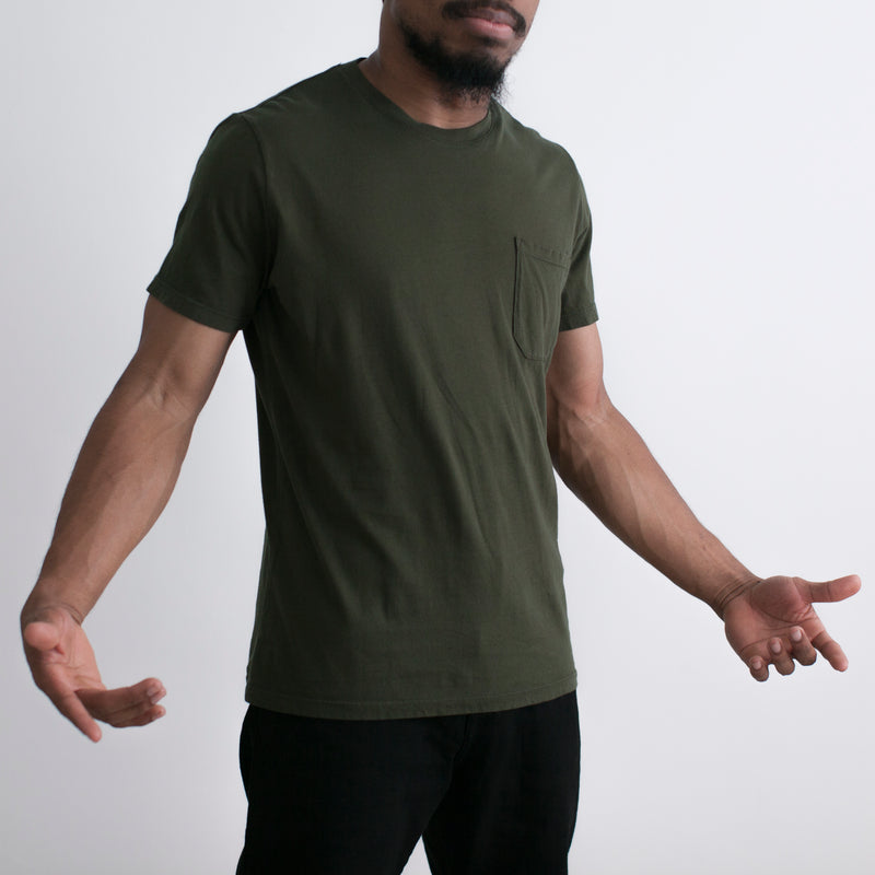 angle: dark moss  Raleigh Denim Workshop a model wears cotton pocket crew neck tee in dark moss