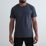 angle: space blue Raleigh Denim Workshop a model wears cotton pocket crew neck tee in space blue