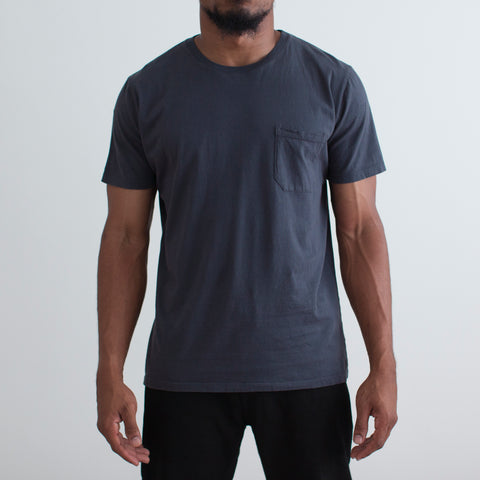 angle: space blue| Raleigh Denim Workshop a model wears cotton pocket crew neck tee in space blue