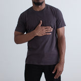 angle: granite  Raleigh Denim Workshop a model wears cotton pocket crew neck tee in granite