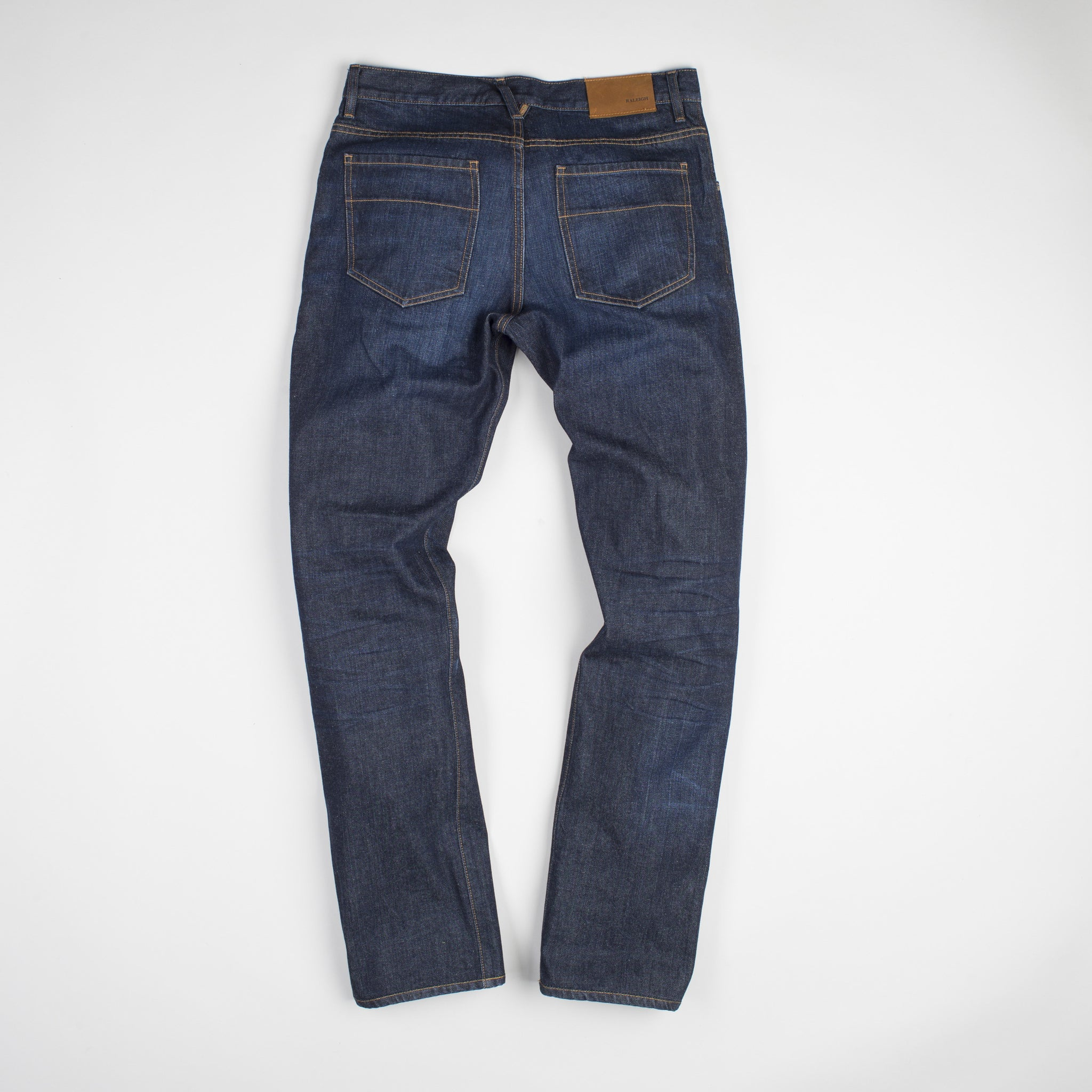 angle: general  Raleigh Denim Workshop Jones thin fit in a general wash, back view