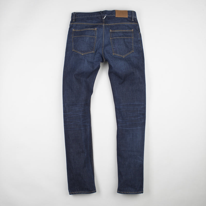 angle hover: staple  Raleigh Denim Workshop Jones thin fit in a dark wash, back view
