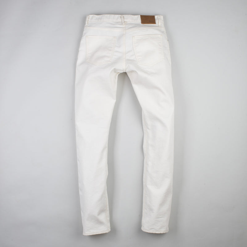 angle hover: natural  Raleigh Denim Workshop Jones thin fit in white, back view