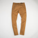 angle: chestnut  Raleigh Denim Workshop Martin thin taper fit stretch pants in orange chestnut, back flat view.