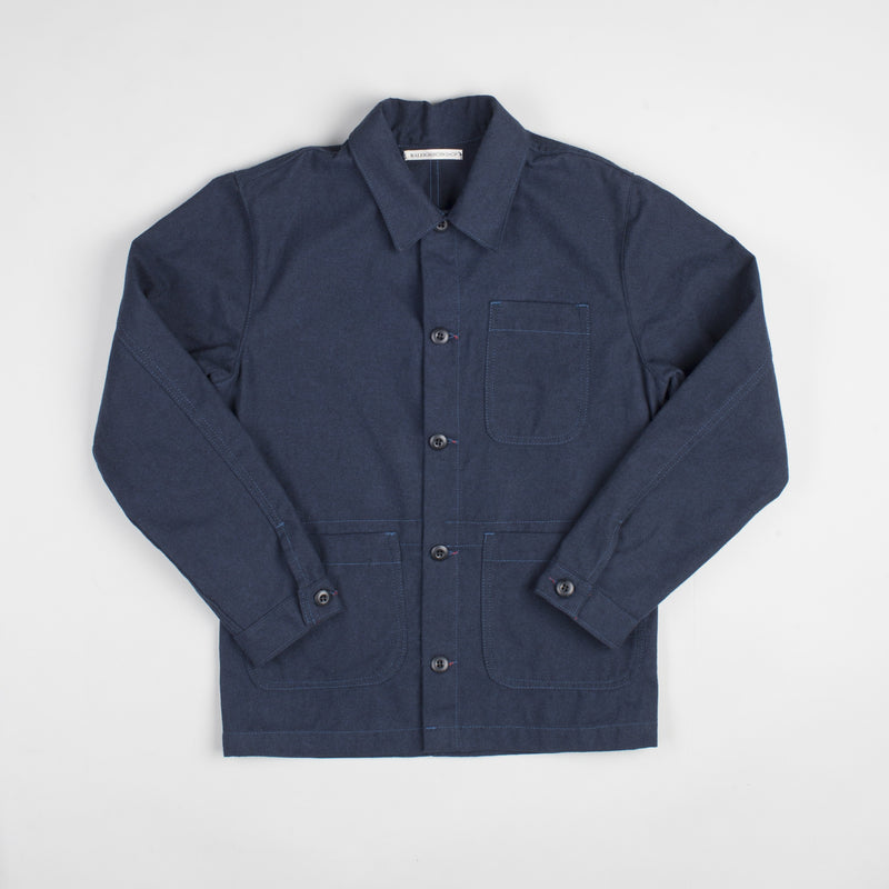angle: navy  Raleigh Denim Workshop men's chore coat in navy blue, front flat view
