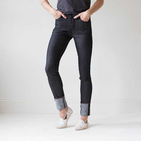 angle: black | A model wears Raleigh Denim Workshop Haywood high-rise skinny jeans in black, front view