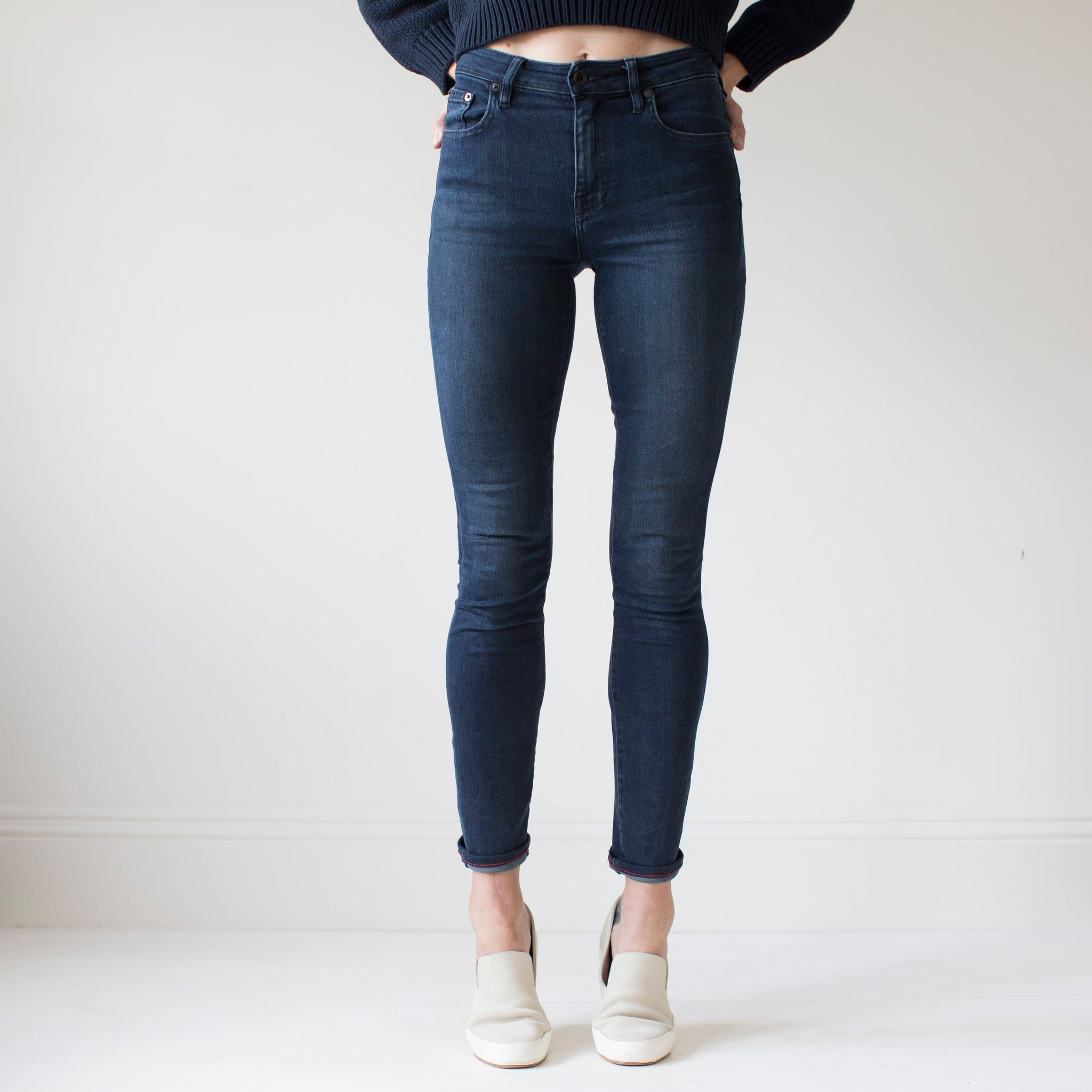 angle: canon  A model wears Raleigh Denim Workshop Haywood high-rise skinny jeans with a dark wash, front view