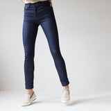 angle hover: indigo  A model wears Raleigh Denim Workshop Haywood high-rise skinny jeans in dark blue, front view